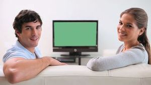 Couple sitting together in front of the television