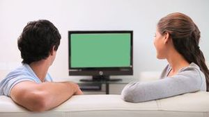 Young couple watching the television
