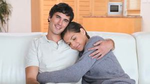Couple sitting together on a couch