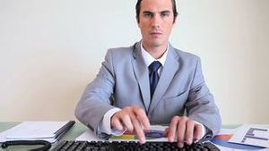 Serious businessman working on documents