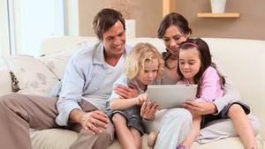 Smiling family using a tablet computer