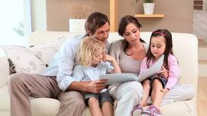 Joyful family reading a book