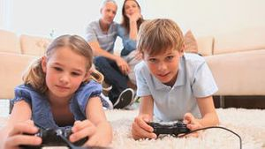 Cute children playing video games