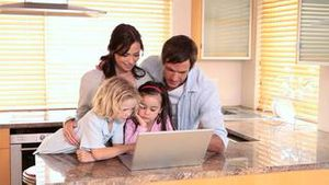 Family looking at a laptop together