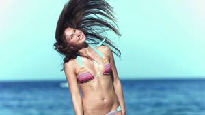 Brunette woman shaking her hair in slow motion