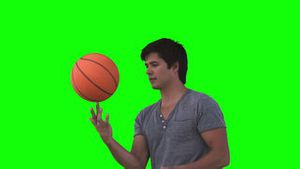 Man playing with a basketball in slow motion