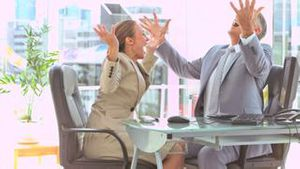 Business people in slow motion raising their arms