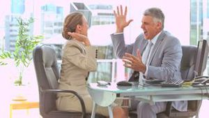 Business people in slow motion giving highfive