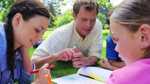 Cheerful family drawing together