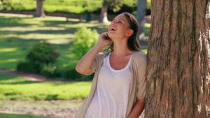 Smiling woman hanging up her mobile phone