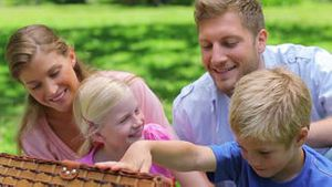 Family looking into a picnic basket