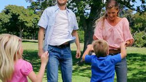 Family jumping excitedly in the park
