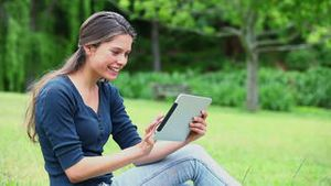 Happy woman using a tablet pc