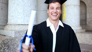 Happy student holding his diploma