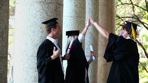 Male graduate comes and gives highfive