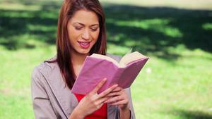 Brunette woman reading an interesting book