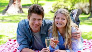 Couple holding glass of champagne