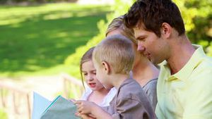 Family holding a picture book