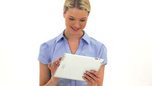 Blonde woman using a tablet pc