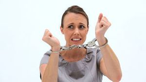Serious woman wearing handcuffs