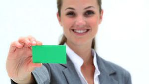 Smiling woman holding a business card