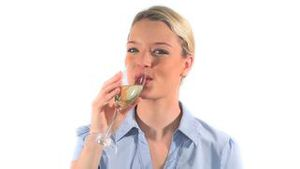 Blonde woman drinking wine