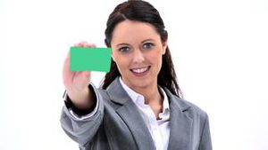 Brunette businesswoman showing a business card