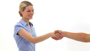 Blonde woman shaking a hand