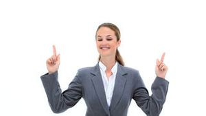 Blonde businesswoman pointing her fingers up