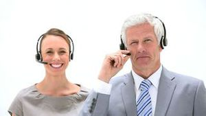 Business people talking into headset