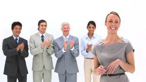Business people applauding a woman