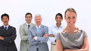 Business people laughing with their arms crossed