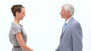 Businesswoman shaking a mans hand