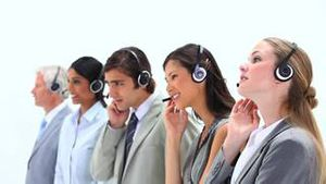People in suits speaking into headset