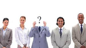 Business people in line with a question mark