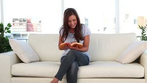 Happy woman reading a book