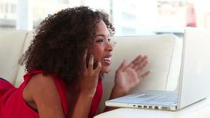 Cheerful woman using a laptop
