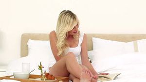 Blonde haired woman reading a book