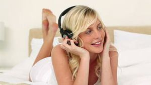 Blonde haired woman listening to music