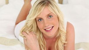 Blonde haired woman touching her hair