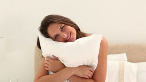 Woman embracing a pillow
