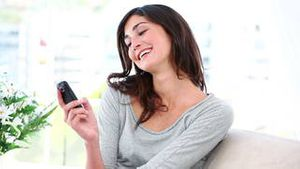 Woman receives and reads a text