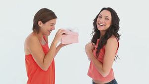 Girl gives friend a present