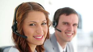 Call centre agents wearing headsets