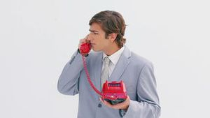Serious man picking up the phone