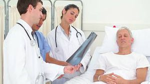 Medical team giving explanations about an xray