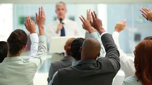 Business people raising their hands together