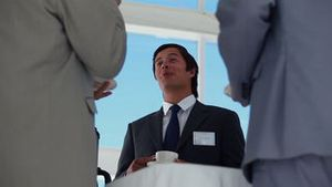 Low angle view of a businessman holding coffee cup