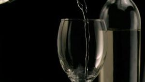 White wine being poured in super slow motion