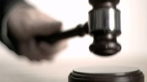 Hand pounding gavel in super slow motion and then put it down